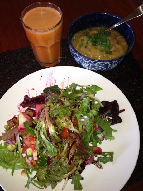 Lunch - carrot and apple juice, Special Soup and yes, there's a baked potato hiding under all that salad.